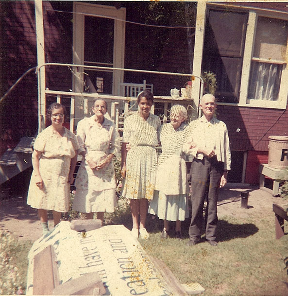 """Theodore backyard Ruth Pope visits from Chicago. 1963."""
