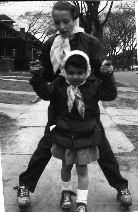 I'm helping Marilyn roller skate. About 1958 on Calvert in Detroit.