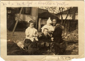 My grandmother holding my mother with Mary V and Mershell and chickens. 1923
