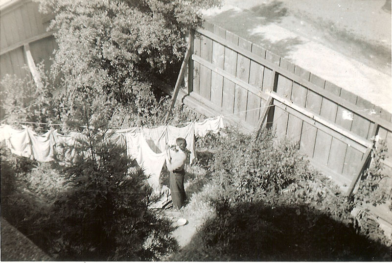 My mother hanging up clothes in San Francisco, 1944.