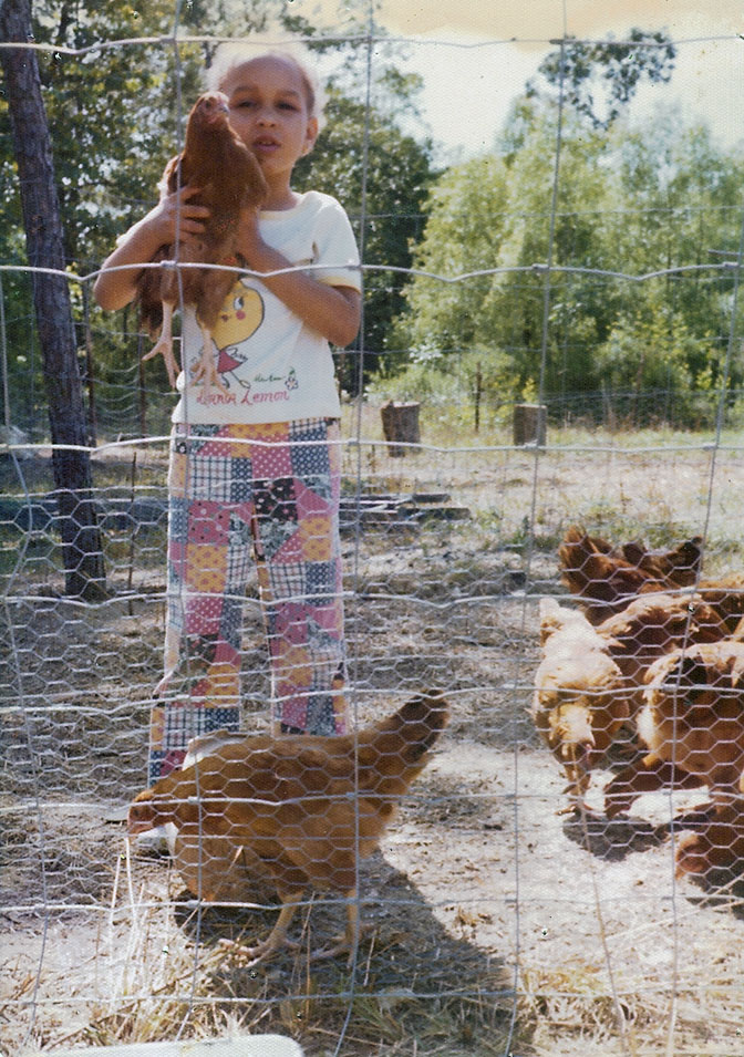 Jilo with a hen. 1973, Mississippi.