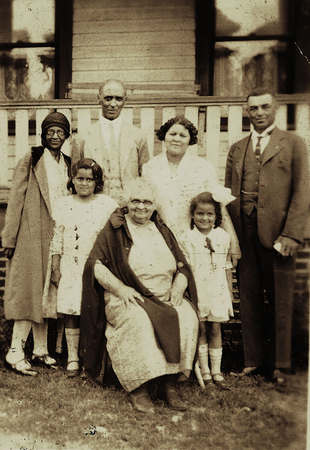 Henry Cleage and family plus two family friends. Early 1930s.