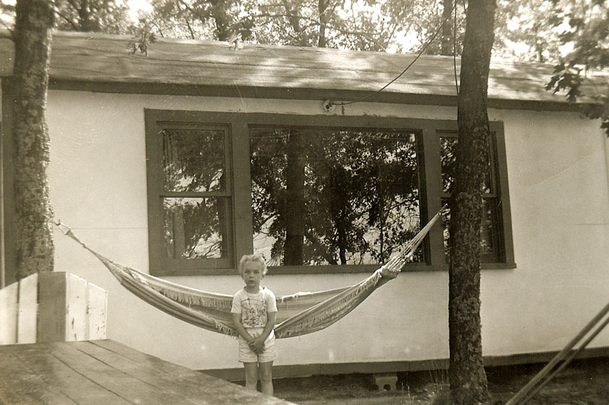 Pearl in front of Louis' old cottage, 1953,