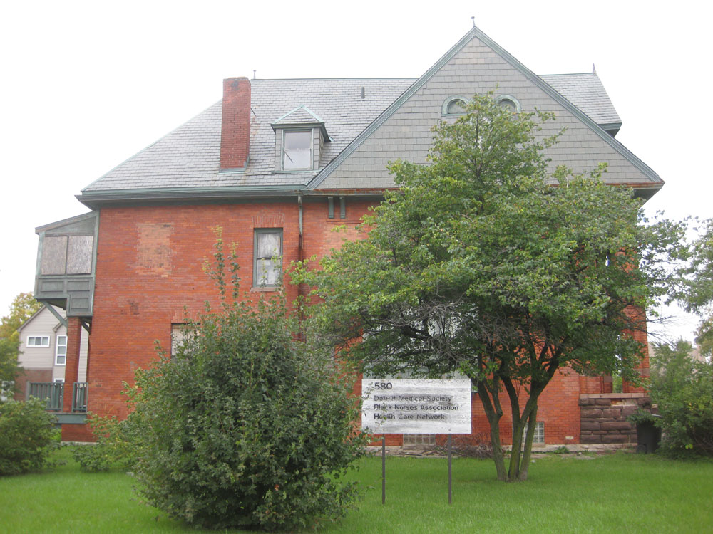 Sign on side of former Dunbar Hosptial. Photo by Paul Lee, Sept 2014.