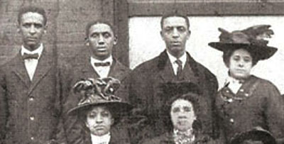 The 3 Cleage brothers and Jacob's wife lived in the house at 910 Fayette Street. Back row: Henry Cleage, Jacob Cleage, Albert Cleage, Pearl Reed. Front: unknown woman, Jacob's wife Gertrude B. Cleage.