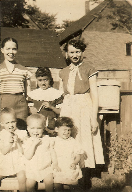 My mother and her sister with cousin Dee Dee inbetween. Front row: Me, sister Pearl and cousin Barbara.