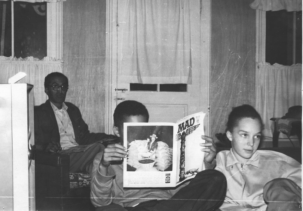 My uncle Hugh, cousin Warren  and sister Pearl in the living room at Old Plank.