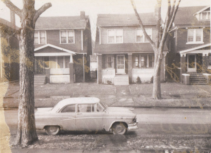 Henry's red and white car. The photo was taken from the house porch.