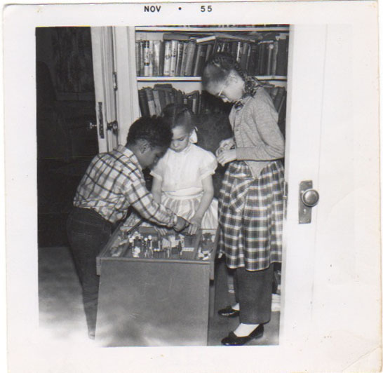 Probably taken the same day as the photo of my mother. My cousin Ernie, sister Pearl seated and me, standing.