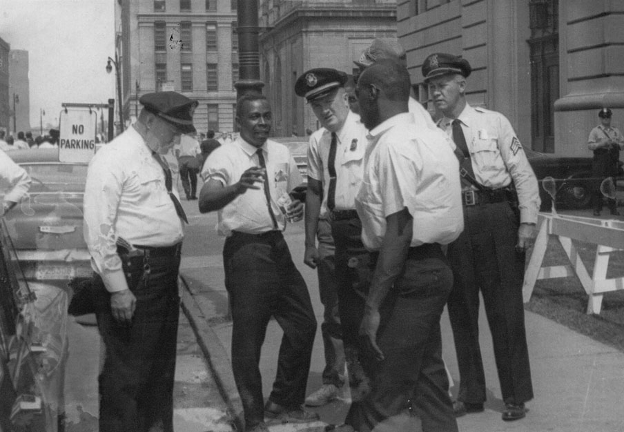 Richard Henry aka Imari Obadela leader of GOAL talking to police during a demonstration.