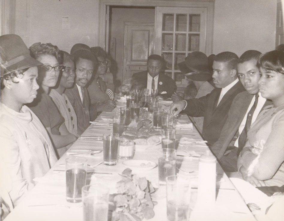 Ed Vaughn, founder of Vaughn's Books. Sitting a few seats away on the left is Arthur Smith who later took an African name, but I can't remember it right now.