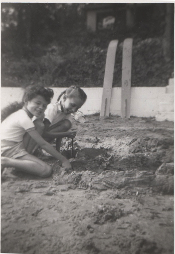 My cousin and me playing in the sand during the visit Louis chased her into the lake.