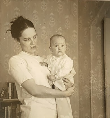 My mother holding me.