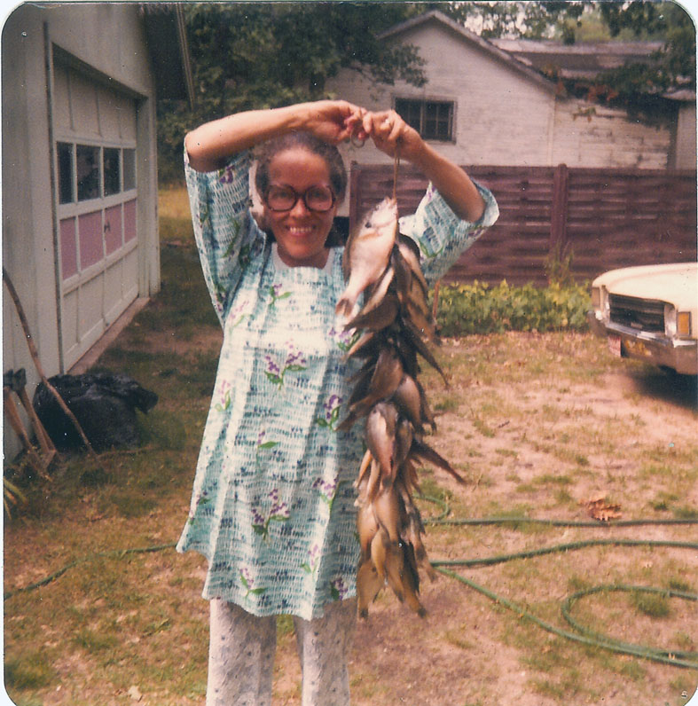My mother, Doris Graham Cleage, holding a string of fish on Water Mill Lake.