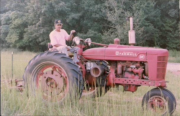 Cousin Warren on tractor.
